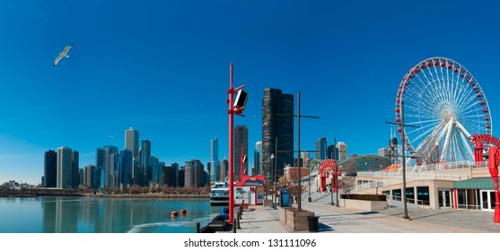 Chicago skyline seen from the Navy Pier. Seagull flying on the left and the Ferris Wheel on the right