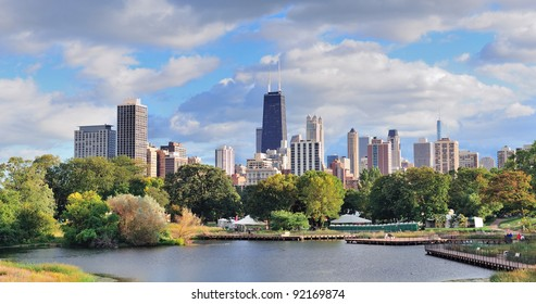Chicago skyline with skyscrapers viewed from Lincoln Park over lake.