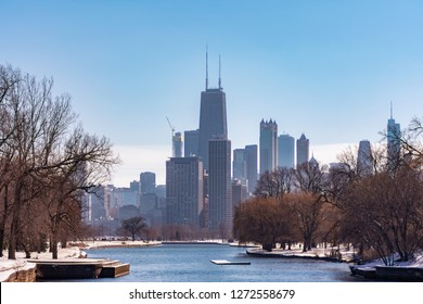 Chicago Skyline from the South Lagoon in Lincoln Park with Snow during Winter