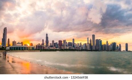 Chicago skyline at sunset with cloudy sky and reflection in water,chicago,illinois,usa.