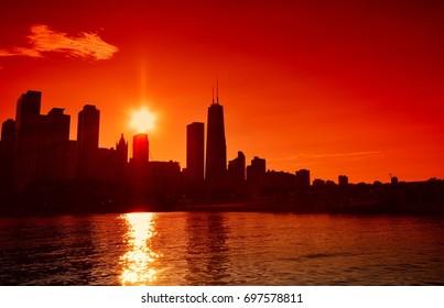 Chicago at sunset skyline across Lake Michigan.