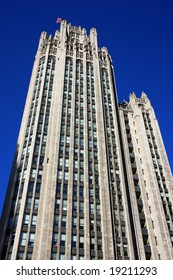Chicago Tribune building framed by clear blue sky in downtown on Michigan Avenue