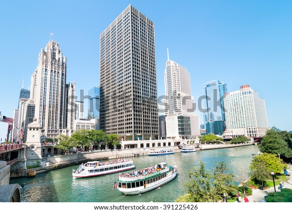 CHICAGO, UNITED STATES - AUGUST 15, 2014: Chicago Architecture Foundation River Cruise, boats traveling towards Lake Michigan.