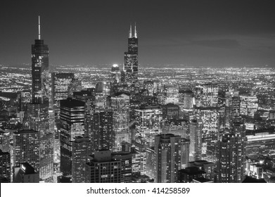 CHICAGO, UNITED STATES - OCTOBER 15, 2012 - at night in black and white landscape of downtown Chicago with skyscrapers lit metropolis of Illinois