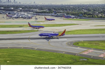 CHICAGO, UNITED STATES - SEPTEMBER 2015: Commercial Southwest Airlines jet landing on Chicago Midway Airport. Midway is second largest airport in Chicago,United States.