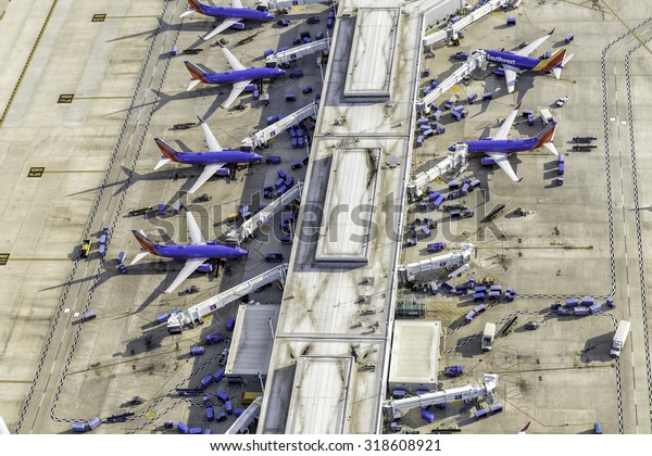 CHICAGO, UNITED STATES - SEPTEMBER 2015: Commercial Southwest Airlines jets on Chicago Midway Airport terminal. Midway is second largest airport in Chicago,United States.