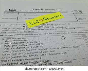 Chicago, US - March 20 2018: Form 1040 Taxes ,LLC vs Partnership , Form1120, Form 1065