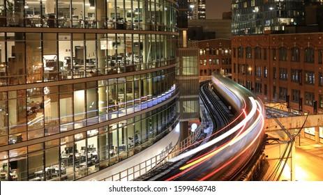 CHICAGO, USA - 16 NOVEMBER 2019: Train gliding through the city at night