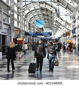 CHICAGO, USA - APRIL 1, 2014: Travelers walk to gates at Chicago O'Hare International Airport in USA. It was the 5th busiest airport in the world with 66,883,271 passengers in 2013.