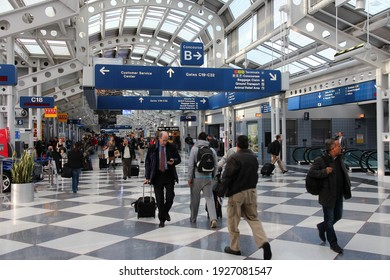 CHICAGO, USA - APRIL 15, 2014: Passengers walk to gate at Chicago O'Hare International Airport in USA. It was the 5th busiest airport in the world with 66,883,271 passengers in 2013.
