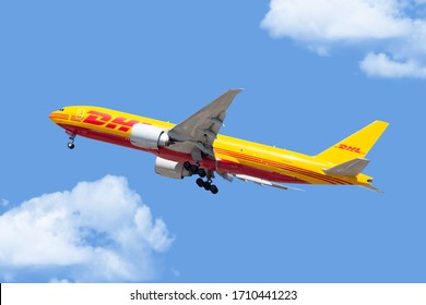 Chicago, USA - April 21, 2020: A DHL Boeing 777 aircraft landing at O'Hare International Airport. DHL is Europe's largest cargo only airline and owned by Deutsche Post.