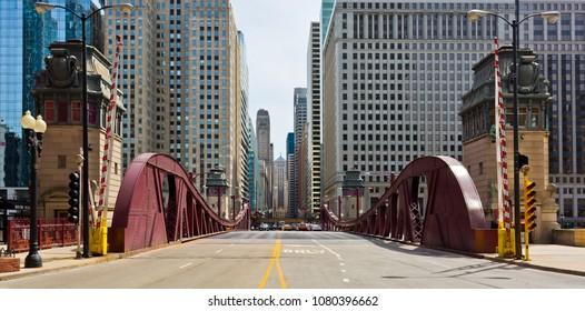 Chicago, USA - April 29, 2018: View of the Chicago Loop from LaSalle Street before the Chicago River. The Board of Trade Building can be seen at the end of the street.