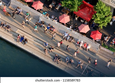 Chicago USA, August 2018 Lifestyle in Chicago. Aerial view of happy people enjoying Saturday afternoon in the Chicago Riverwalk. Having fun, walking, talking and drinking