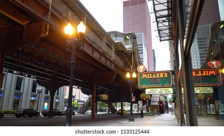 Chicago, USA - Circa 2019: Day time exterior Millers Pub in downtown Chicago under the L train tracks over street level. Color over sign for generic usage