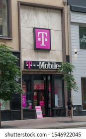 Chicago, USA - Circa 2019: T-Mobile retail store location exterior storefront facade photo. Wireliess cell phone service provider.