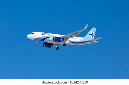Chicago, USA - February 13, 2018: An Interjet Aribus A-320 landing at O'Hare International Airport. Interjet is a Mexican low-cost airline based in Toluca.