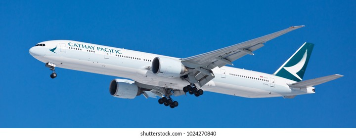 Chicago, USA - February 13, 2018: Cathay Pacific Airlines Boeing 777-300 aircraft on final approach at O'Hare International Airport. Cathay Pacific Airlines Limited is the flag carrier of Hong Kong.