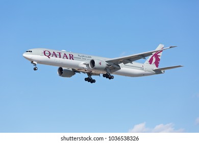 Chicago, USA - February 28, 2018: A Boeing 777-300ER aircraft of Qatar Airways landing at the O'Hare International Airport. Qatar Airways is the national airline of Qatar, based in Doha.