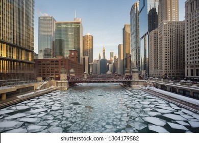 Chicago, USA - February 4, 2019: The Chicago skyline with its frozen Chicago River in Winter.
