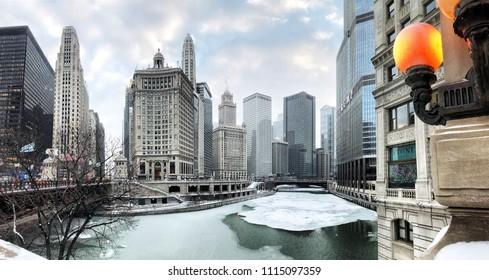 CHICAGO, USA - JANUARY 15, 2018: Architecture modern buildings and Michigan Avenue bridge (Dusable bridge) over frozen Chicago river in winter. Panoramic Chicago cityscape.