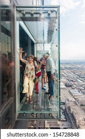 CHICAGO, USA, JULY 09: Unidentified people on the skydeck in the Willis Tower on July 09, 2012 in Chicago. Willis Tower  is a 108-story, 1,451-foot (442 m) skyscraper in Chicago, Illinois.