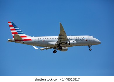 Chicago, USA - July 11, 2019: American Eagle Embraer ERJ-170 aircraft landing at O'Hare International Airport.