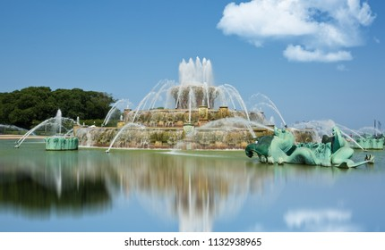 Chicago, USA - July 12, 2018: Chicago's Buckingham Fountain, one of the largest in the world, in the windy city's Grant Park on a beautiful summer day with no skyline or buildings in the background.