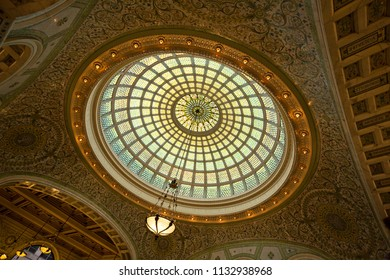Chicago, USA - July 12, 2018: A Tiffany Stained Glass Ceiling hangs above the atrium at the Chicago Cultural Center. It is reported to be the largest Tiffany made window in the world.
