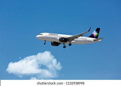 Chicago, USA - July 12, 2018: A Volaris Airlines Airbus A320 aircraft on final approach to O'Hare International Airport.
