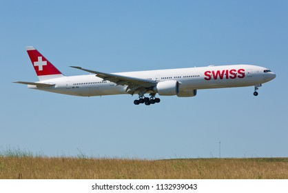 Chicago, USA - July 12, 2018: Swiss airline Boeing 777 on final approach to O'Hare International Airport. Swiss is the national airline of Switzerland.