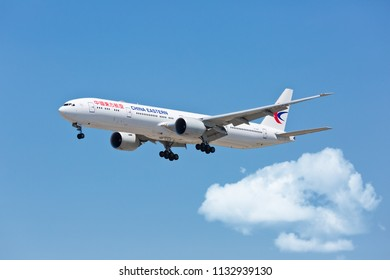 Chicago, USA - July 12, 2018: A China Eastern Airlines Boeing 777-300  aircraft on final approach to O'Hare International Airport.