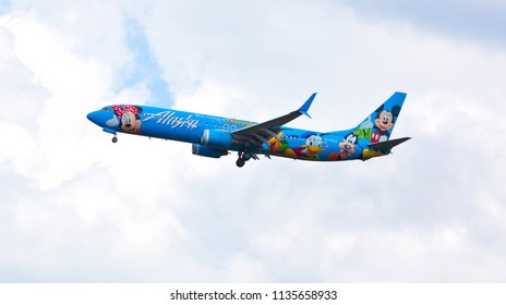 Chicago, USA - July 16, 2018: Alaska Airlines Boeing 737 (Disney Livery) on final approach to O'Hare International Airport.