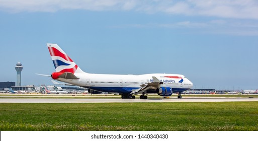 Chicago, USA - July 2, 2019: Boeing 747 British Airways lands at O'Hare International Airport.