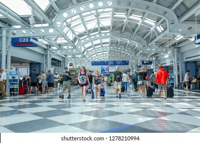 CHICAGO, USA - July 20, 2018: Travelers walk to gates at Chicago O'Hare International Airport in USA.