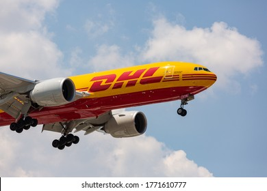 Chicago, USA - July 7, 2020: A DHL Boeing 777 aircraft at O'Hare International Airport. DHL is Europe's largest cargo only airline and owned by Deutsche Post.