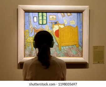 Chicago, USA - June 06, 2018: Woman look at the The Bedroom by Vincent van Gogh painting in Art Institute of Chicago.