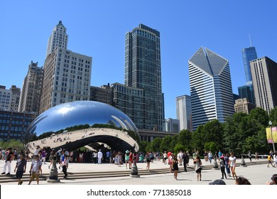 Chicago, USA - June, 17, 2016: People enjoying the view of the of the skyscrapers in the reflection of the Chicago Cloud Gate in Millennium Park.