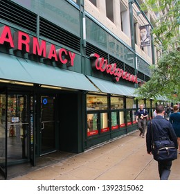 CHICAGO, USA - JUNE 26, 2013: People walk by Walgreens Pharmacy in Chicago. Walgreens is the largest drug retail chain in the United States with 8,300 stores in 50 states.