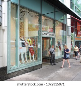 CHICAGO, USA - JUNE 26, 2013: People enter Ann Taylor store at Magnificent Mile in Chicago. The Magnificent Mile is one of most prestigious shopping districts in the United States.