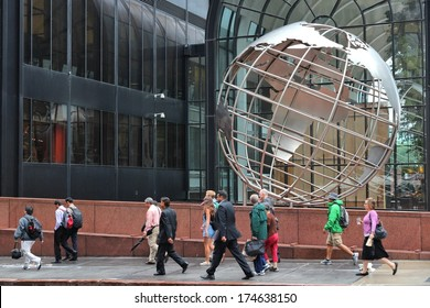 CHICAGO, USA - JUNE 26, 2013: People walk by Willis Tower globe sculpture in Chicago. Chicago is the 3rd most populous US city with 2.7 million residents (8.7 million in its urban area).