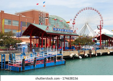 CHICAGO, USA - JUNE 26, 2013: People visit famous Navy Pier in Chicago. The 3,300-foot pier built in 1916 is one of most recognized Chicago landmarks.