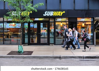 CHICAGO, USA - JUNE 26, 2013: People walk past Subway sandwich store in Chicago. Subway is one of fastest growing restaurant franchises with 39,747 restaurants in 101 countries.
