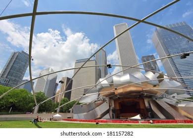 CHICAGO, USA - JUNE 27, 2013: People visit Jay Pritzker Pavilion in Millennium Park in Chicago. Jay Pritzker Pavilion is a famous bandshell designed by Frank Gehry.