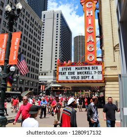 CHICAGO, USA - JUNE 28, 2013: People walk past Chicago Theatre. Chicago Theatre was founded in 1921 and is a registered Chicago Landmark.