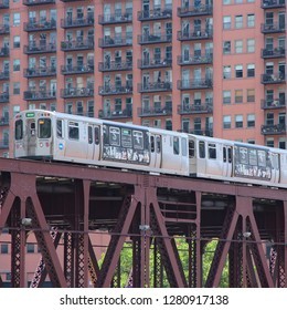 CHICAGO, USA - JUNE 28, 2013: People ride Chicago's elevated train. L train system served 231 million rides in 2012.