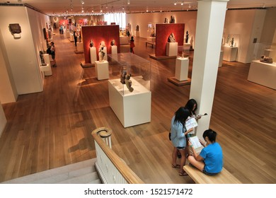 CHICAGO, USA - JUNE 28, 2013: Visitors admire ancient art at famous Art Institute of Chicago. It is the 2nd largest art museum in the US with 1 million square feet of area.