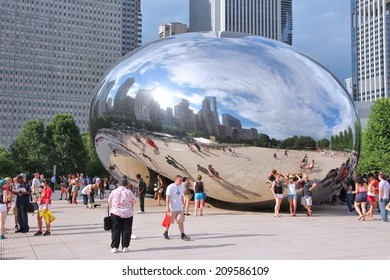 CHICAGO, USA - JUNE 28, 2013: People visit Cloud Gate in Millennium Park in Chicago. With 2.7 million residents, Chicago is the 3rd most populous city in the USA.