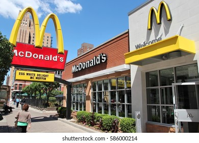 CHICAGO, USA - JUNE 28, 2013: People walk by McDonald's restaurant in Chicago. McDonald's is the 2nd most successful restaurant franchise in the world with 33,000 locations.