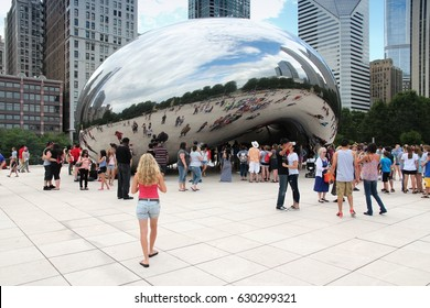 CHICAGO, USA - JUNE 28, 2013: People visit Cloud Gate (a.k.a. The Bean) in Millennium Park in Chicago. With 2.7 million residents, Chicago is the 3rd most populous city in the USA.
