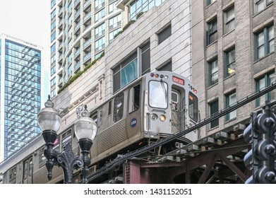CHICAGO, USA - MARCH 14, 2019: Train on the The Loop in downtown Chicago. The Loop is a 1.8 mile long circuit of elevated rail but also a nickname for downtown Chicago enclosed by this circuit.